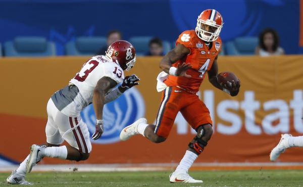Clemson quarterback Deshaun Watson runs past Oklahoma's Ahmad Thomas during the college playoff semifinal game on New Year's Eve. Clemson won 37-17.