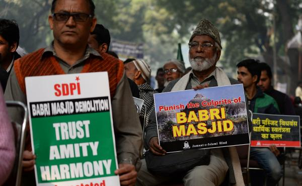 Indian activists carry placards displaying images of the Babri mosque during a December 2016 protest in New Delhi to mark the anniversary of the mosque's destruction in 1992.