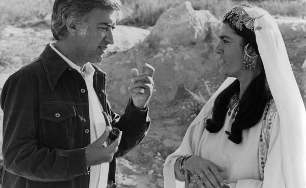 Director Moustapha Akkad (left) with actress Irene Papas during the filming of The Message. The film depicts the life of the Prophet Muhammad.