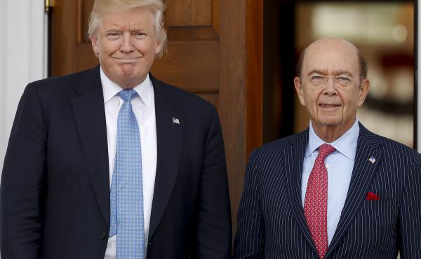 President-elect Donald Trump pauses for photographs with investor Wilbur Ross at the Trump National Golf Club in Bedminster, N.J., on Nov. 20. Trump plans to nominate Ross to serve as commerce secretary.