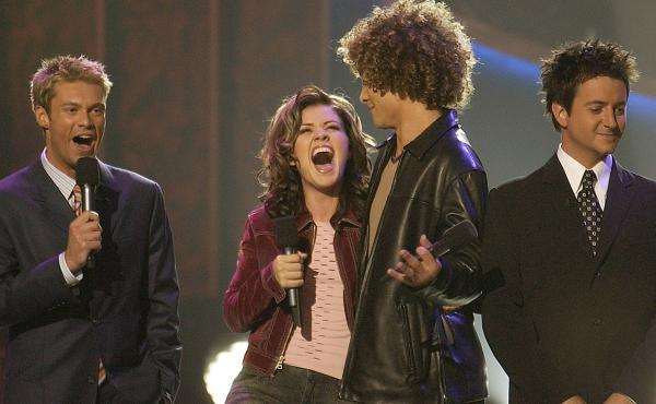 Kelly Clarkson won the first season of American Idol in September 2002 over Justin Guarini, in front of co-hosts Ryan Seacrest and Brian Dunkleman, who almost looks aware that this would be his only season.
