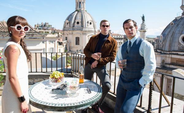 Gaby Teller (Alicia Vikander,) Illya Kuryakin (Armie Hammer,) and Napoleon Solo (Henry Cavill) in a scene from The Man from U.N.C.L.E.