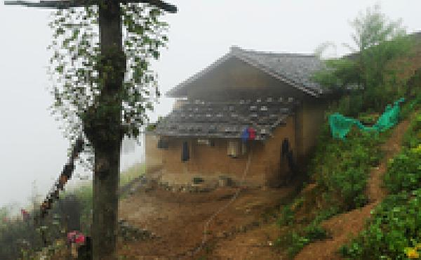 The Mose family lives in a mud-brick farmhouse in Atule'er village, a poor, isolated community of 72 ethnic Yi families atop a mountain in southwest China's Sichuan Province.