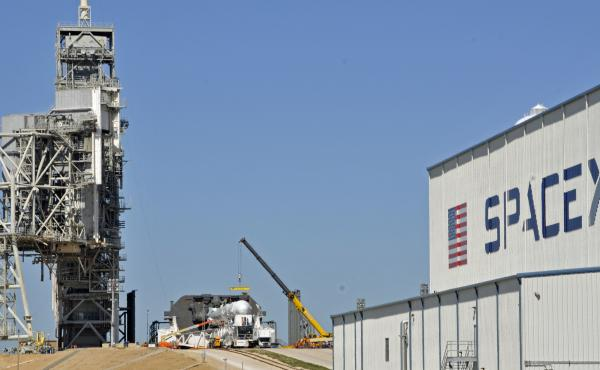 SpaceX's Falcon 9 rocket is prepared Friday for a launch at the Kennedy Space Center in Florida. Launch Pad 39A, one of the renovated space shuttle launch pads that SpaceX leases from NASA, has been the site of many of NASA's most famous liftoffs.