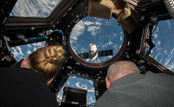 In July 2016, Rubins (left) and Jeff Williams (right), inside the International Space Station, maneuvered a supply spacecraft for docking.