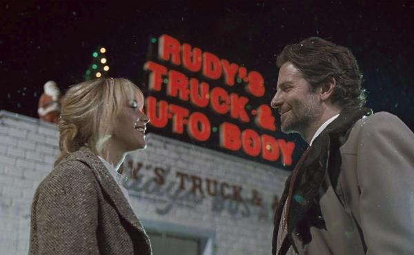 Jennifer Lawrence and Bradley Cooper in a scene from Joy.