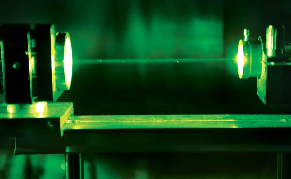 A nanosecond pulsed laser beam starts the photoacoustic imaging process.
