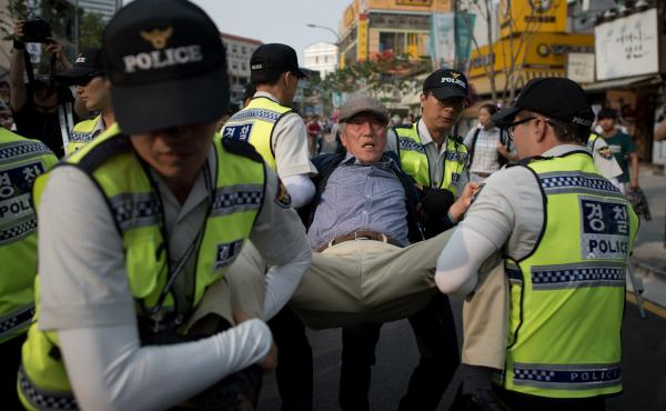 A religious activist is carried away by police after he tried to stop a gay pride parade in Seoul last year. Christian activists are planning to disrupt the parade again this year.