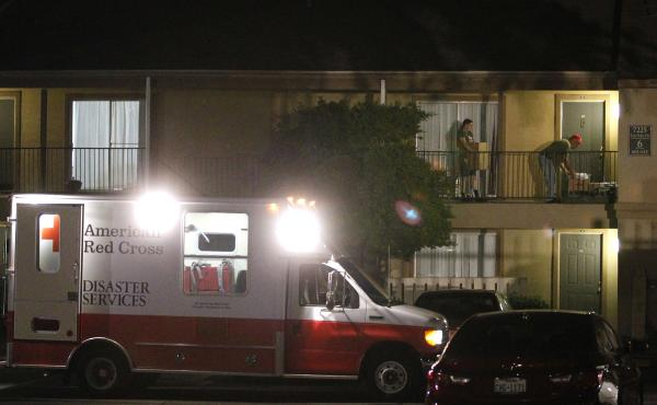 A Red Cross worker delivers bedding to a unit at The Ivy Apartments in Dallas, where a man diagnosed with the Ebola virus had been staying.