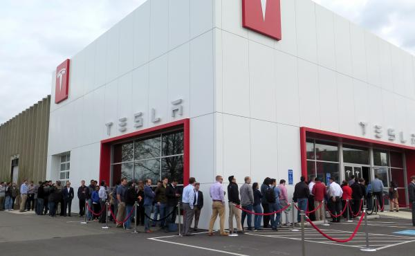 Customers lined up at a Tesla store on Thursday to put in down payments for the new Tesla Model 3 in the Washington, D.C., suburb of Tysons Corner, Va.