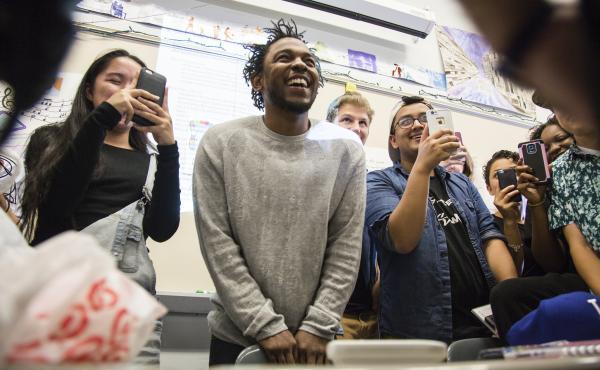 Kendrick Lamar visits Brian Mooney's English classes at High Tech High School in North Bergen, N.J., on Monday.