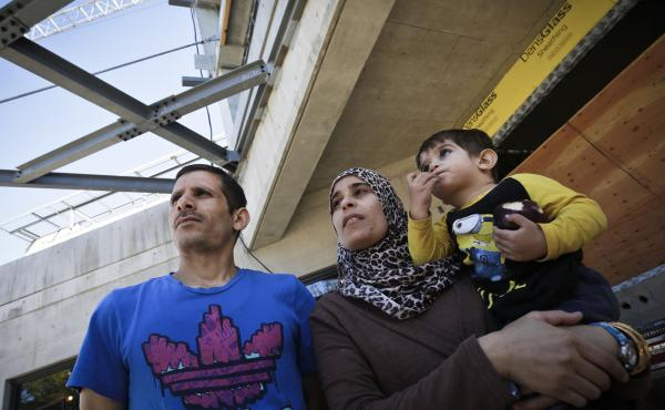 A refugee family from Syria visits a new refugees facility under construction in Vancouver, Canada, on Sept. 10. The country is expected to welcome some 25,000 Syrians by the end of the year.