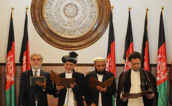 Ashraf Ghani (second from left) stands next to Afghanistan's Chief Executive Abdullah Abdullah (left) and two deputy officials as he takes the oath during the inauguration ceremony at the presidential palace in Kabul on Monday.