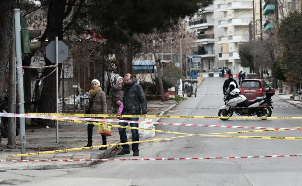 Residents leave their houses in Thessaloniki, Greece, on Sunday as part of a mandatory evacuation. It preceded an operation to defuse a World War II bomb discovered there.