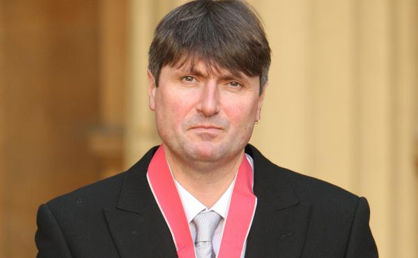 Simon Armitage frowns with dignity after being awarded the Commander of the British Empire medal at Buckingham Palace in 2010. Though he began the nomination process for the Oxford post as an underdog, he emerged from the ensuing drama with the professors