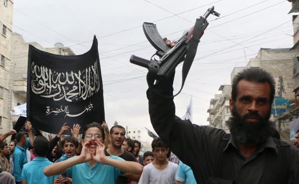 Supporters of the al-Nusra Front protest in Aleppo, Syria, on Sept. 26, days after airstrikes there targeted the al-Qaida unit called Khorasan. U.S. officials say some top Khorasan leaders were embedded with the Nusra Front, al-Qaida's arm in Syria.