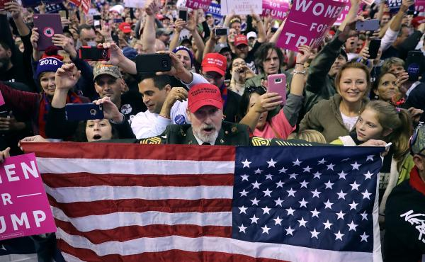 Donald Trump supporters cheer for him during a Nov. 4 campaign rally in Hershey, Pa.