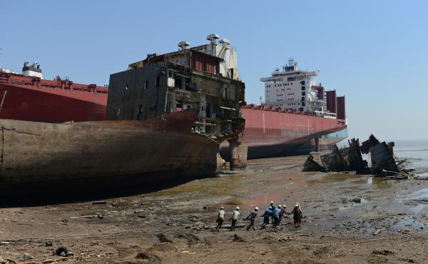 Indian shipbreakers work at the Sosiya-Alang Ship Recycling yard on March 4, 2013. Many ships are heading to scrap heaps, like this one, the world's largest, to help reduce the number competing for market share.