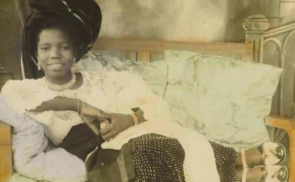 """The hand-colored photo, titled """"Reclining young lady,"""" is of Stella Osarhiere Gbinigie when she was 16."""