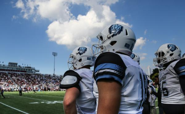 Columbia University players watch hopefully as they take on Fordham University. Despite a good start, the game ended in a loss for the Lions.