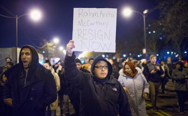 Demonstrators call for the resignation of Chicago Mayor Rahm Emanuel, Police Superintendent Garry McCarthy and Cook County State's Attorney Anita Alvarez during a protest on Nov. 24 following the release of a video showing Chicago police Officer Jason Van