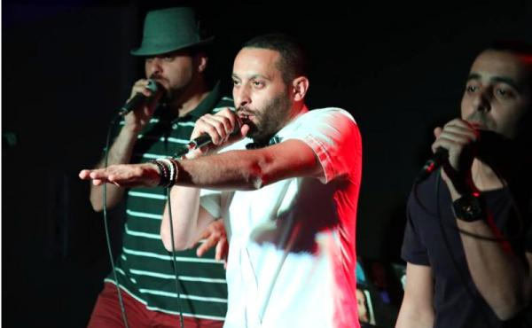Tamer Nafar (center), performs with the hip-hop group DAM. The members are all Arabs who are citizens of Israel, and some of their lyrics are harshly critical of the state. They see it as artistic freedom, while Israel's culture minister says such languag