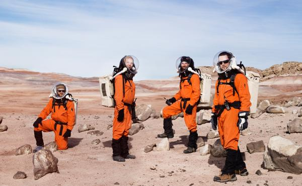 Mars, anyone? Six researchers from the Mars Society sport their best space duds during this 2014 simulation of the conditions that explorers of the Red Planet might face. (From left) Ian Silversides, Anastasiya Stepanova, Alexandre Mangeot and Claude-Mich
