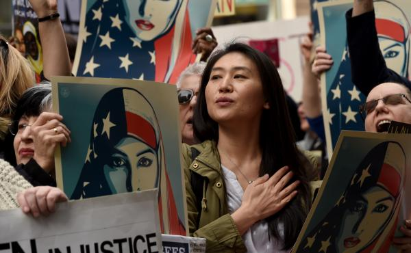 Protesters march in New York's Times Square on February 19, 2017, in solidarity with American Muslims and against the travel ban ordered by President Donald Trump.