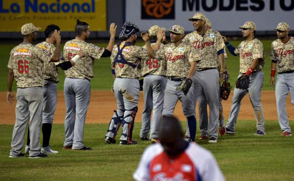 Venezuelan players celebrate after beating Cuba in the Dominican Republic on Feb. 4. More than 20 U.S. major league teams established baseball academies in Venezuela in the 1990s; currently, more than 60 Venezuelans are in the major leagues. But the turmo