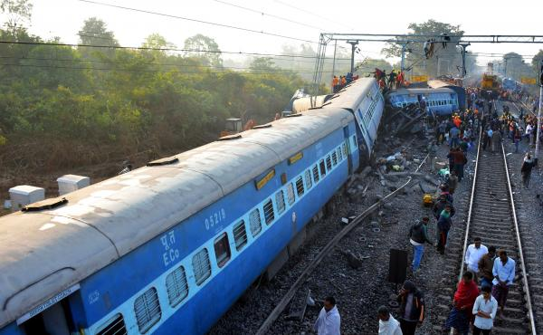 Rescue workers search for victims at from the Jagdalpur-Bhubaneswar express train that derailed near Kuneru station in southern Andhra Pradesh state on Sunday.