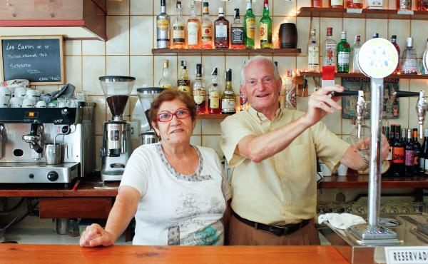 Pedro Barros Diéguez and Albina Macia Fernández, the husband-and-wife owners of Casa Pages, a traditional bar in Barcelona. Many of the city's historic, family-run businesses are in danger of closing because of rising rents, spurred by a huge spike in t