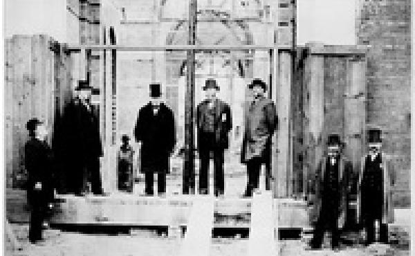 Members of the National Museum Building Committee stand in an unfinished doorway of the U.S. National Museum, now the Arts and Industries Building, in 1880. (From left: Gen. Montgomery C. Meigs, Gen. William Tecumseh Sherman, Peter Parker, Spencer Fullert