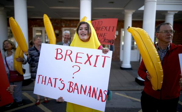 """Anti-Brexit supporters dressed as bananas protest outside a racecourse in York, England. """"It is absolutely crazy that the EU is telling us what shape our bananas have got to be,"""" says Brexit's foremost cheerleader, Boris Johnson, the former mayor of Londo"""