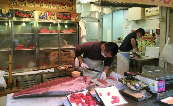 A vendor at Tokyo's famed Tsukiji Fish Market butchers a Pacific bluefin tuna caught in waters off Mexico.