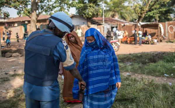 A Burundian soldier of the U.N. peacekeeping force MINUSCA contingent uses a metal detector at the entrance of a polling station in Bangui, Central African Republic on Dec. 14, 2015.