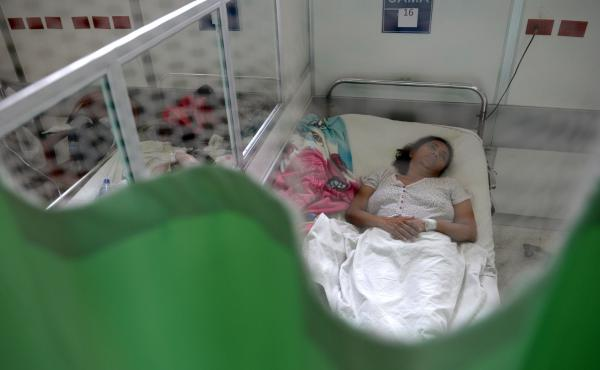 A patient suffering from Guillain-Barre syndrome recovers in a hospital ward in San Salvador on Jan. 27. Researchers are trying to determine whether there is a link between the disorder, which can cause weakness and paralysis, and the mosquito-borne Zika