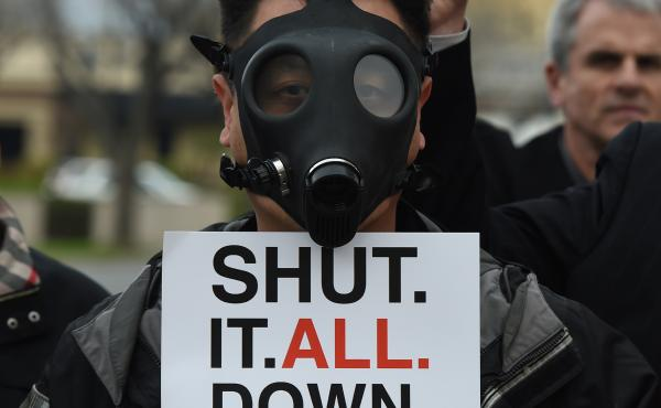 A Porter Ranch resident wears a gas mask during a protest Saturday outside a meeting of the Air Quality Management Board over the Aliso Canyon gas leak. The leak started in October and has forced thousands of residents to flee from the Los Angeles suburb