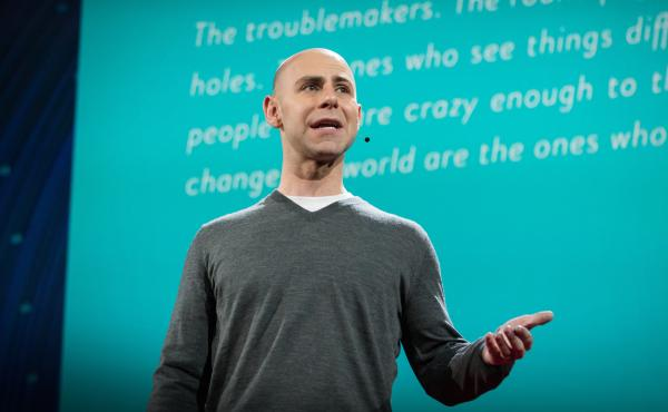 Adam Grant on the TED Stage.