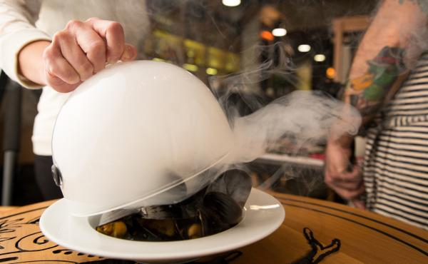 This dish — mussels smoked in pine needles and pine ash butter — was inspired by a 1605 recipe that the explorer Samuel de Champlain made for his men while traveling through Canada. It's one of many historically inspired items on the menu at the Toron
