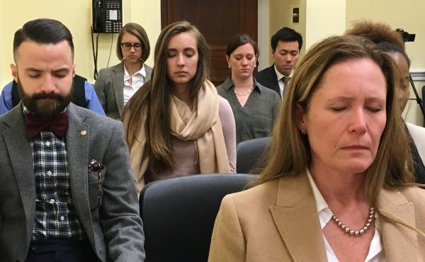 Capitol Hill staffers meditate.
