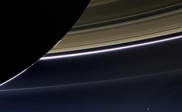 An image taken on July 19, 2013, by the wide-angle camera on NASA's Cassini spacecraft captured Saturn, its rings and planet Earth, which is the tiny dot in the lower right.