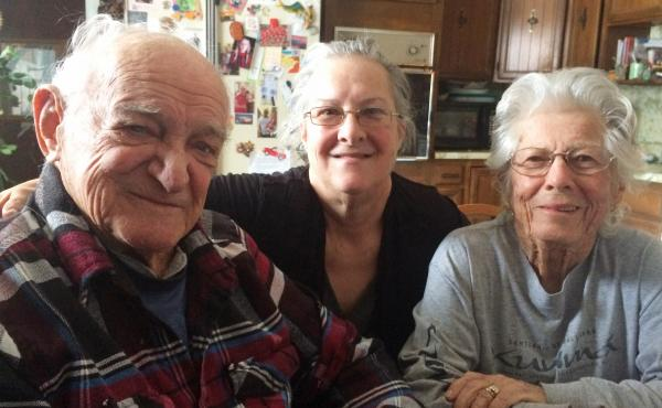 Bob Ebeling with his daughter Kathy (center) and his wife, Darlene.