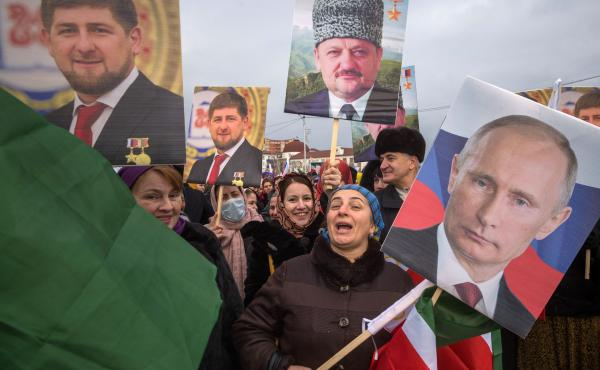 Chechen leader Ramzan Kadyrov (poster in top left) is a staunch supporter of Russian President Vladimir Putin, but both men have been criticized by human rights groups. Tens of thousands of people took part in a state-sponsored rally in Chechnya's capital