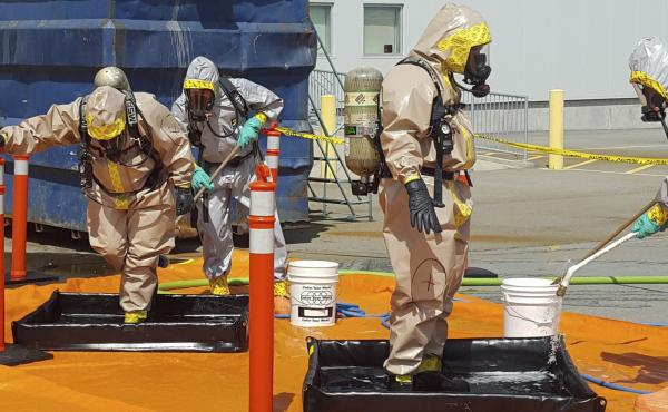 Members of the Royal Canadian Mounted Police go through a decontamination procedure after intercepting a package containing around 1 kilogram (2.2 pounds) of the powerful opioid carfentanil, imported from China to Vancouver. China has now added the drug t