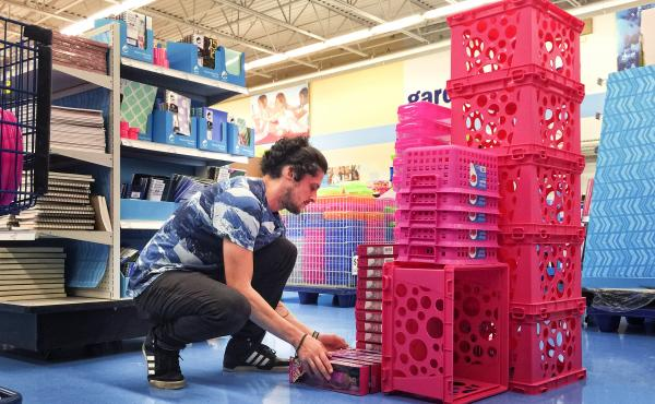 Carson Brown, a 30-year-old photographer, constructs a sculpture at Meijer, a large retailer in Michigan.