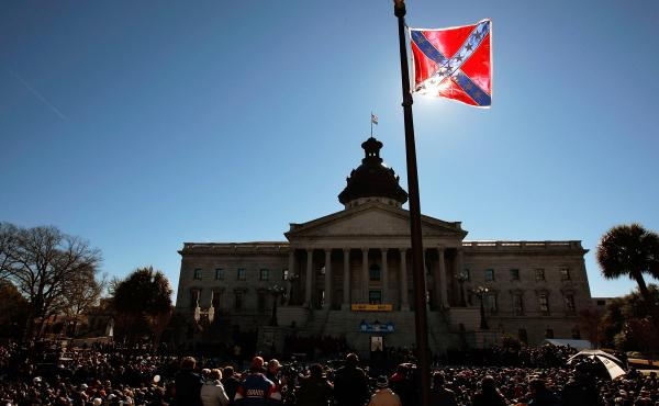 A Confederate flag that's part of a Civil War memorial on the grounds of the South Carolina State House flies during a Martin Luther King Day rally in 2008. The state is under fire for continuing to fly the flag.