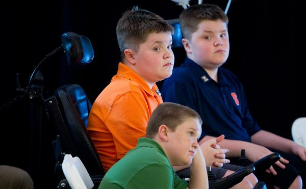 Duchenne muscular dystrophy patients Jack Willis (center), Nolan Willis (right) and Max LeClaire, attended the opening of Sarepta Therapeutics new headquarters in Cambridge, Mass., in 2014.