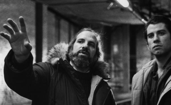 Director Brian De Palma and John Travolta on the set of Blow Out.