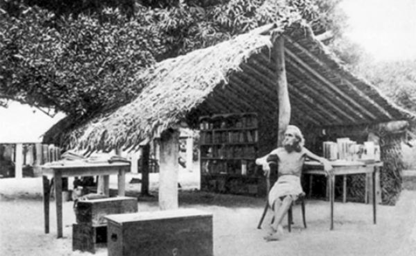 German nudist August Engelhardt sits in front of his thatched tent-like hut on the island of Kabakon (in what is now Papua New Guinea) with the books that he brought with him from Germany. In 1902, he moved to the South Pacific to start a utopian cult tha