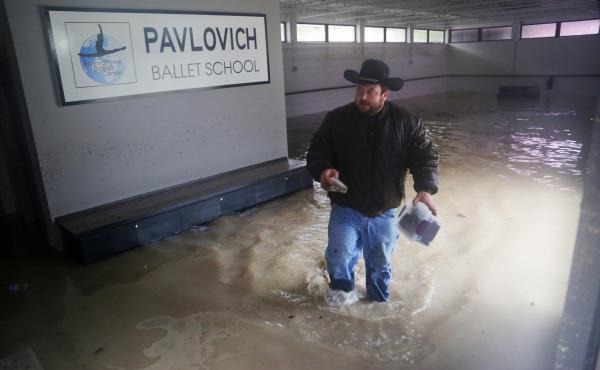 Pictured is the inside of the Pavlovich Ballet School Building, home of the Columbia Classical Ballet, as electrical crews shut off power Monday, in Columbia, S.C.